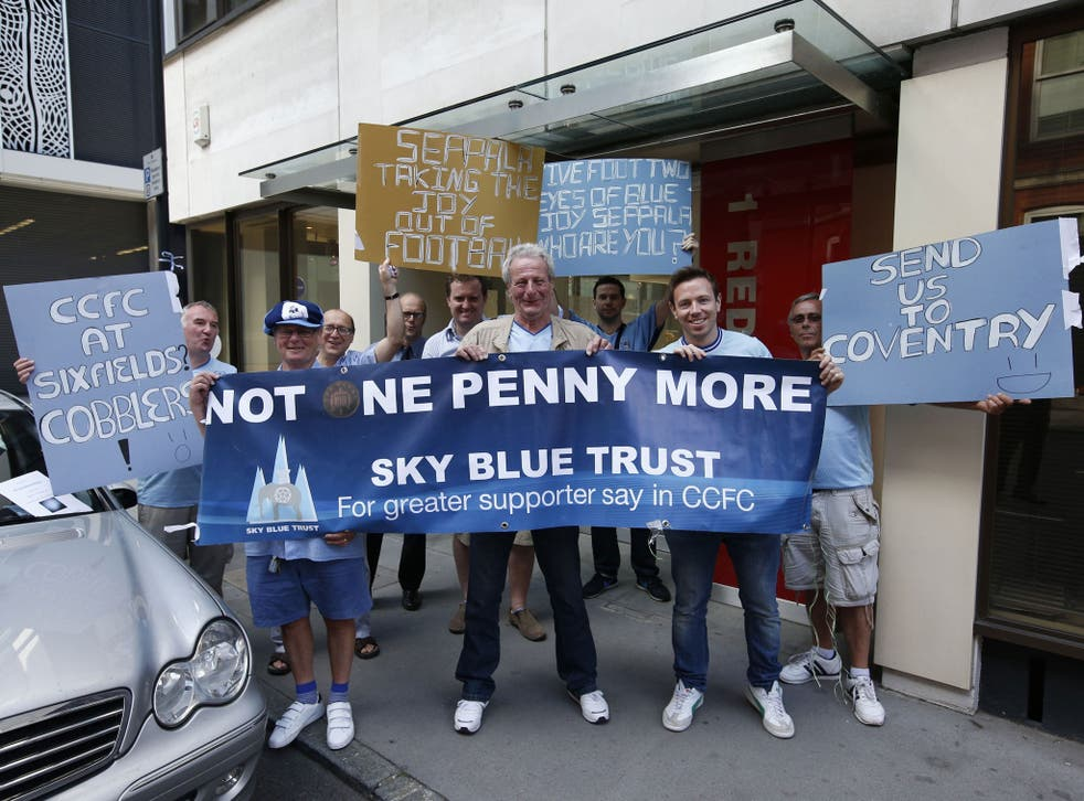 Worrying signs: Coventry City fans outside the club owners' offices protest against the ground-share at Northampton