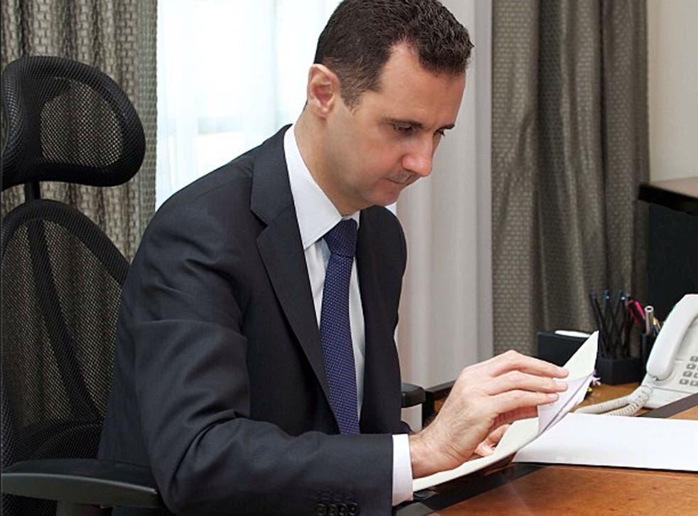 Bashar al-Assad working in his office