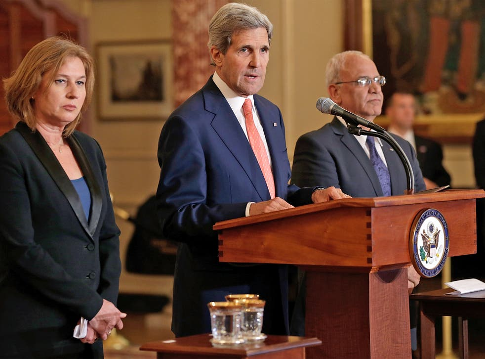 US Secretary of State John Kerry makes a statement with Israeli Justice Minister Tzipi Livni (left) and Palestinian chief negotiator Saeb Erekat during a press conference on the Middle East Peace Process Talks, in Washington