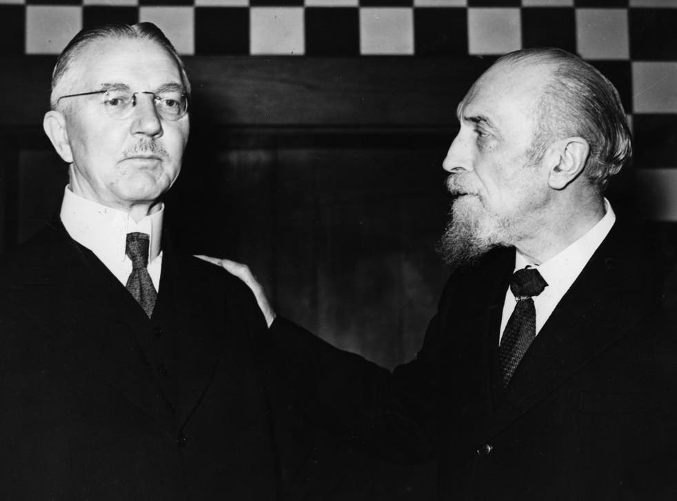 Montagu Collet Norman (right), Governor of the Bank of England from 1920 to 1944, talks with Hjalmar Schacht , German financier and Hitler's minister of economics in around 1935