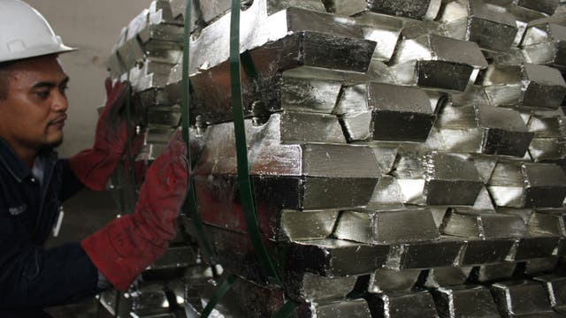 January 24, 2012A worker makes a final check of refined tin ahead of shipment in a warehouse owned by a private company in Indonesia's Bangka-Belitung province January 16, 2012. REUTERS/Dwi Sadmoko