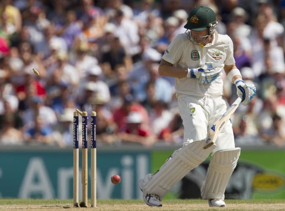 Michael Clarke reacts after he is bowled for 187 by Stuart Broad