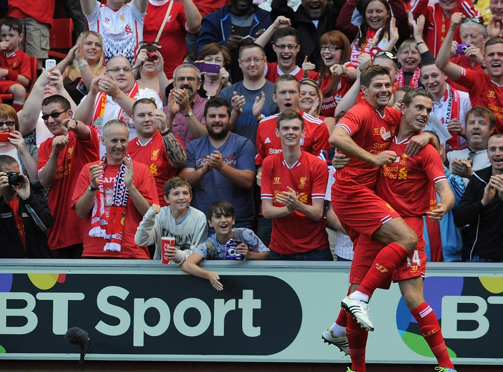 Liverpool duo Steven Gerrard and Jordan Henderson celebrate after the latter scored in the former's testimonial match against Olympiacos