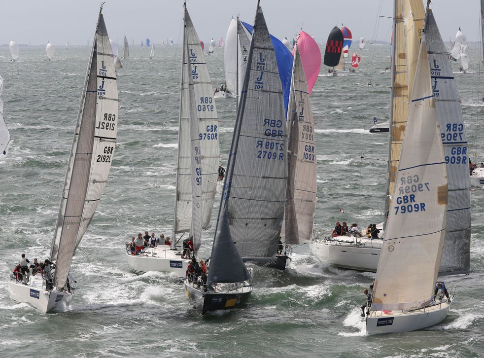 A jumble of J109s jostles for position approaching a mark rounding in the Solent on the second day of AAM Cowes Week.