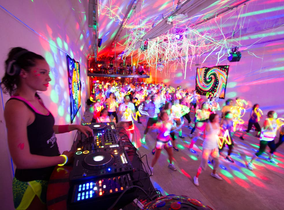 Move to the music: clubbers feel the beat at one of Fitness Freak's pop-up raves in London. The idea of fitness parties originated in the United States