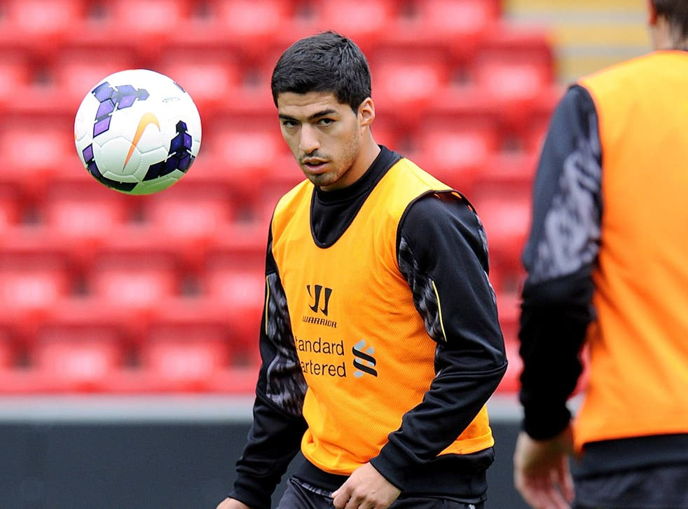 Luis Suarez takes part in an open training session