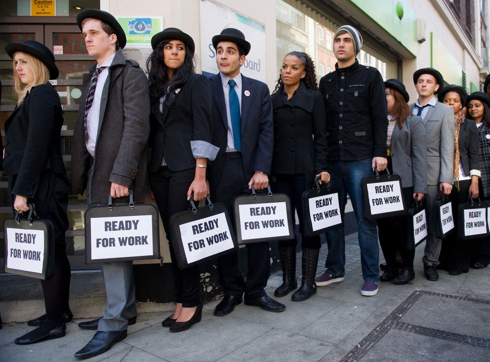 British musicians Miss Dynamite (5th L) and Charlie Simpson (6th L) join unemployed young people as they stand in line outside a job centre in central London during a photocall for the Battlefront Campaign