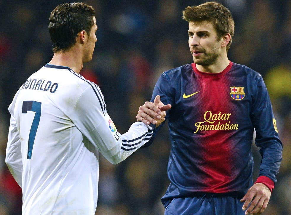 Real Madrid's Cristiano Ronaldo and Barcelona's Gerard Pique during a Copa del Rey tie earlier this year