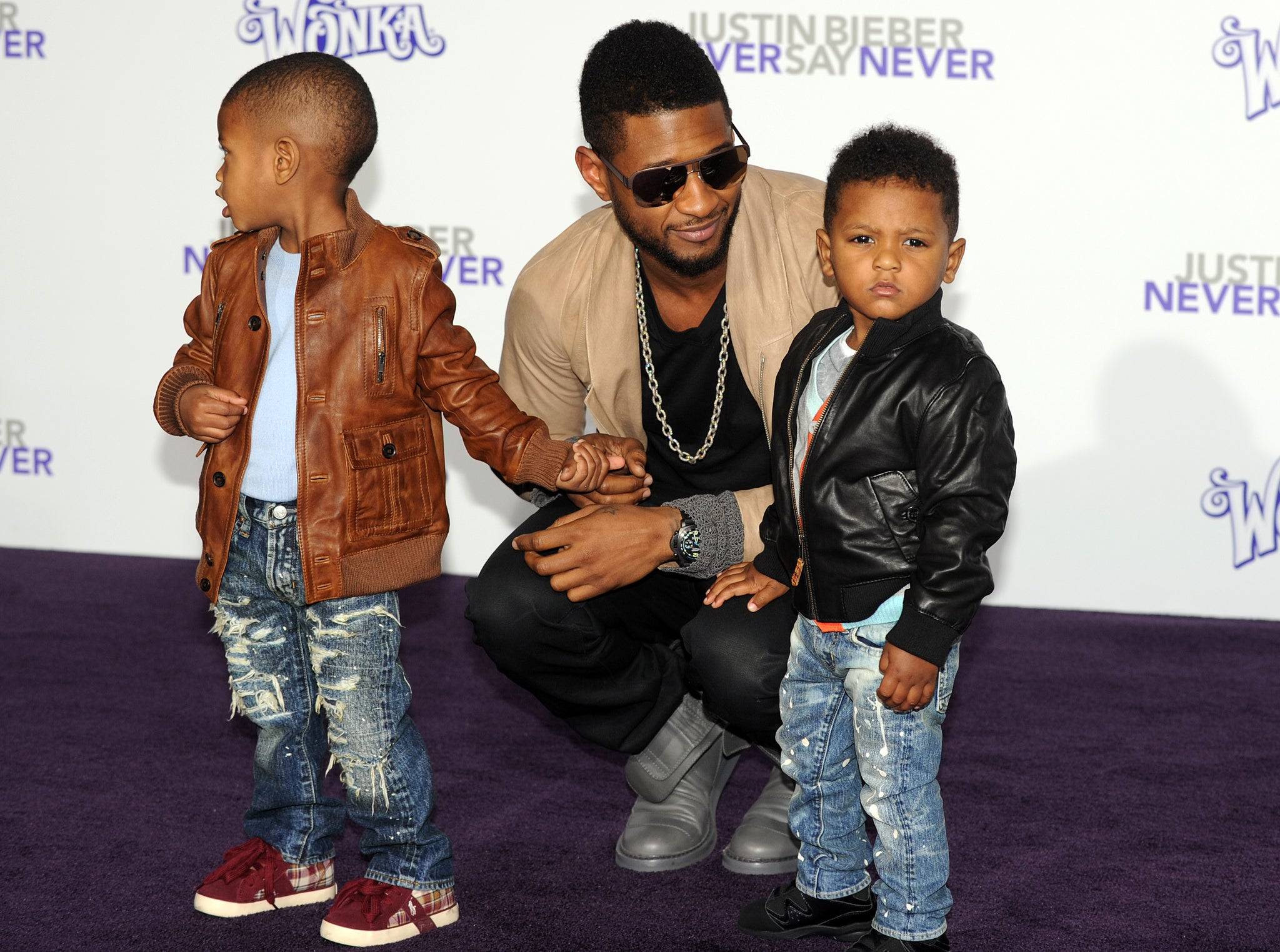 Usher S Son Aged Five Hospitalised After Being Caught In