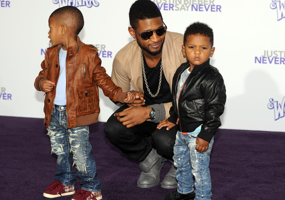 Usher's son, aged five, hospitalised after being caught in
