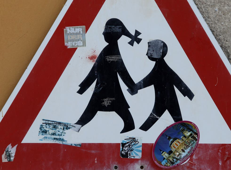 A traffic sign depicting children is pictured at the Benedictine-run Ettal Monastery is pictured on March 12, 2010 in Ettal, Germany.