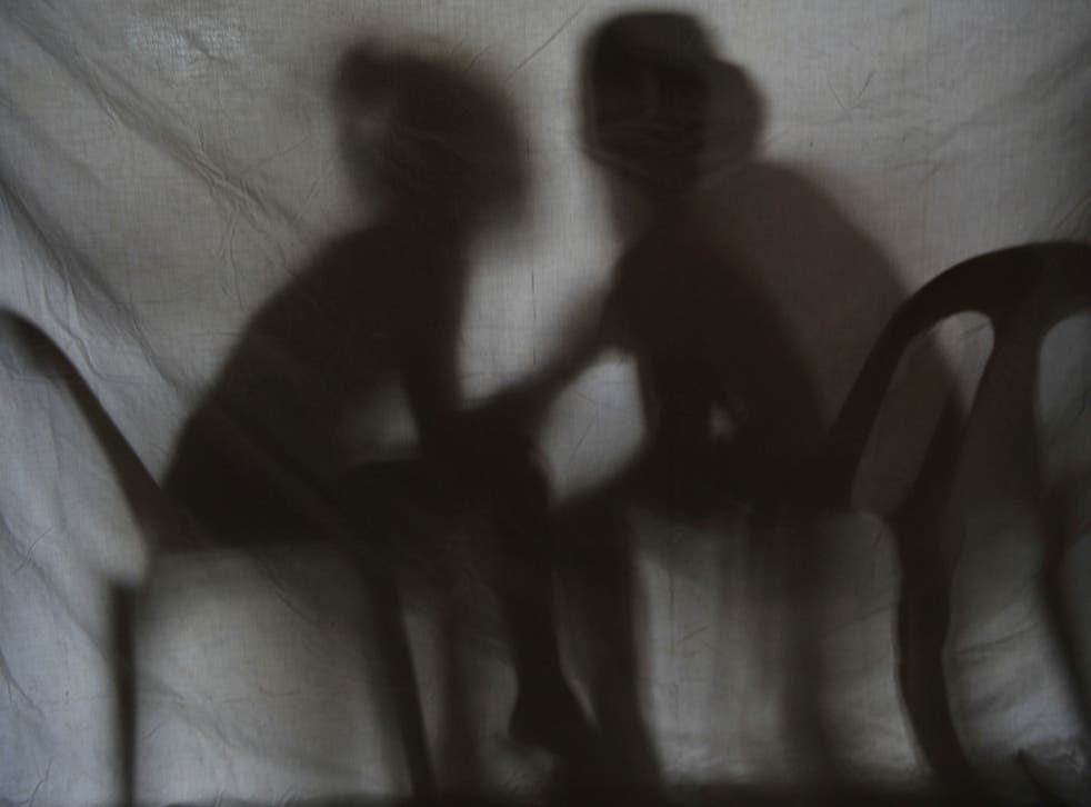 The shadow of two teenage girls rescued from a cyber sex den is seen in this photo taken at Preda Foundation office on December 2, 2010 in Olongapo City, Zambales province, north of Manila.