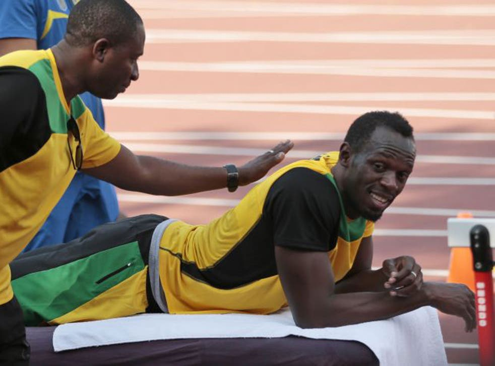 Usain Bolt waits for a massage during Jamaica's training session
