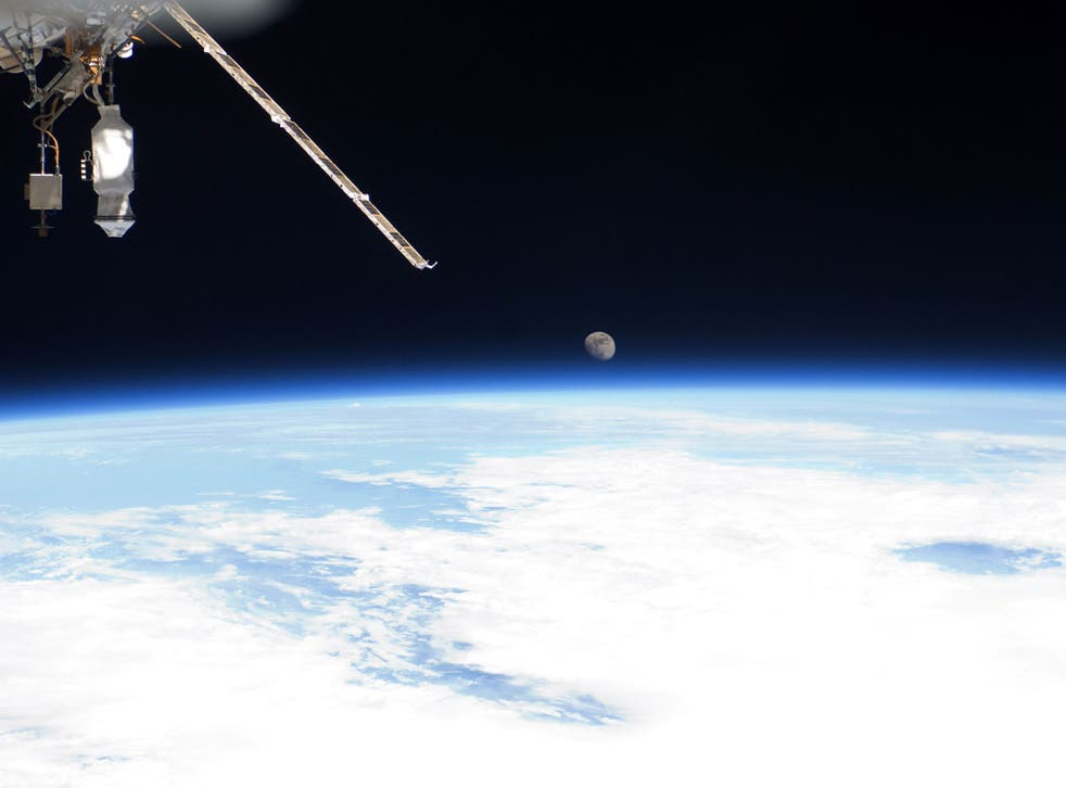 Earth's horizon and the moon seen from the International Space Station July 12, 2011