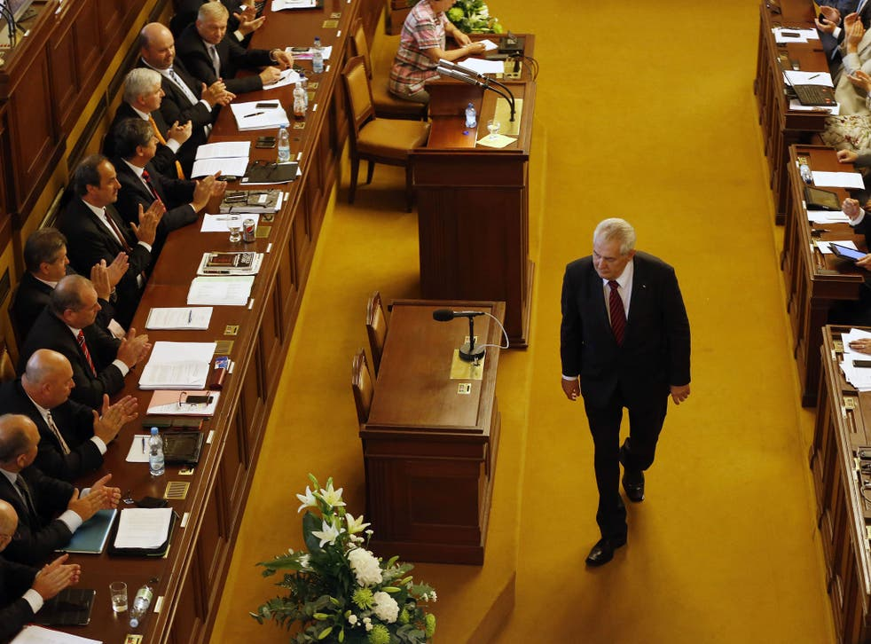 Milos Zeman walks past representatives after delivering a speech during a Parliament session in Prague. Czech Republic's Parliament gathered for a confidence vote for a newly appointed government led by Jiri Rusnok