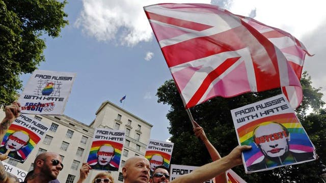 Protesters outside Downing Street against Vladimir Putin's homophobic laws