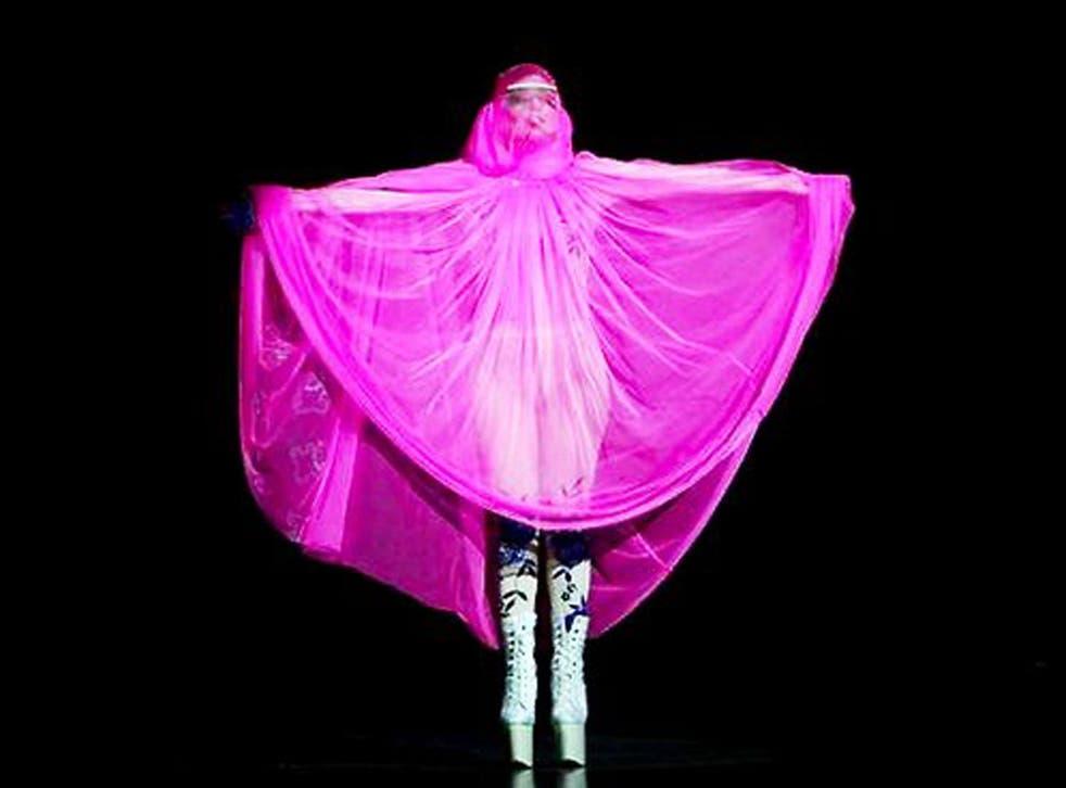 Lady Gaga performs in a pink 'burqa'