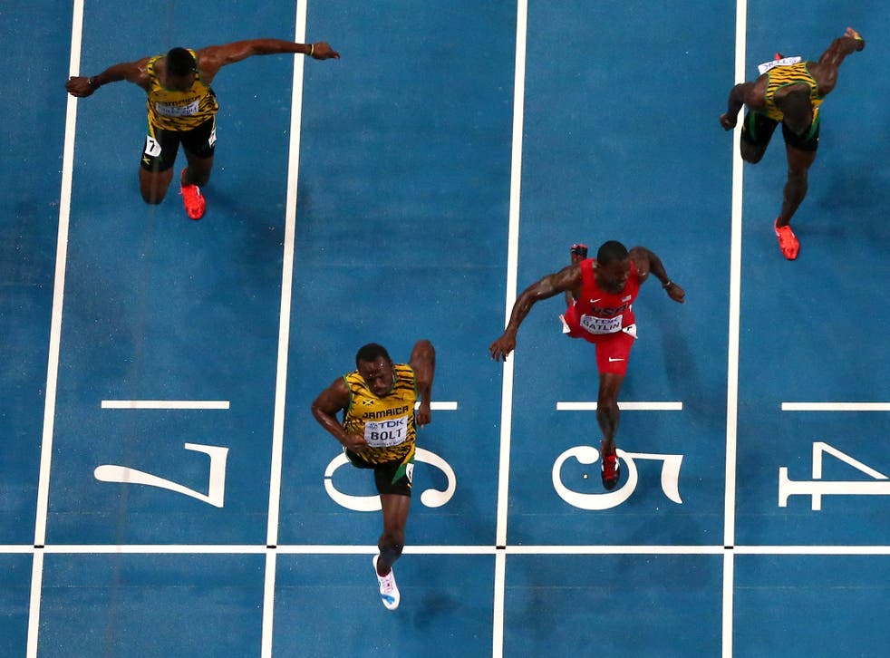 Usain Bolt held off the challenge by American Justin Gatlin, who clocked 9.85secs, with Jamaican Nesta Carter getting bronze in 9.95s