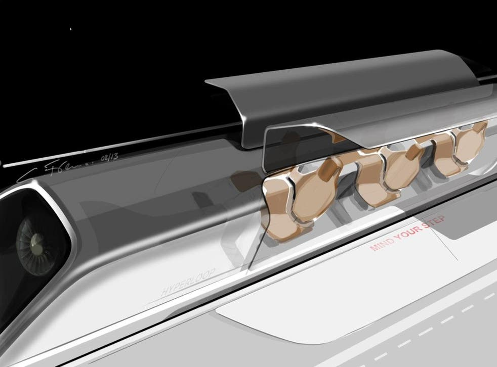 An image of the Hyperloop passenger capsule with doors open at the station