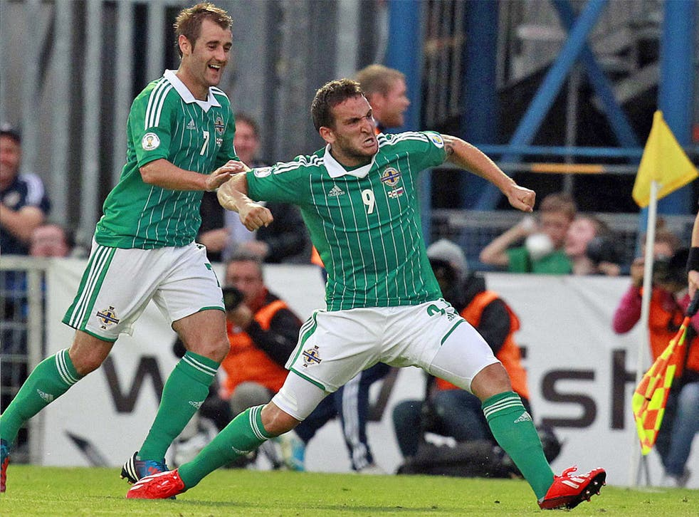 Northern Ireland's Martin Paterson is congratulated by team-mate Niall McGinn after scoring the winner against Russia
