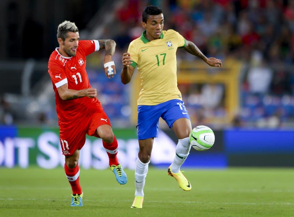 Luiz Gustavo in action for Brazil against Switzerland