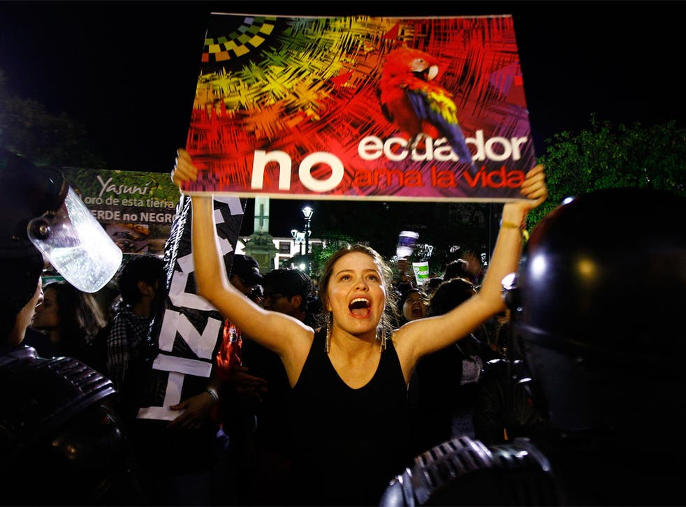 Demonstrators protest against the decision to drill for oil in the Amazon and, below, President Correa's TV address