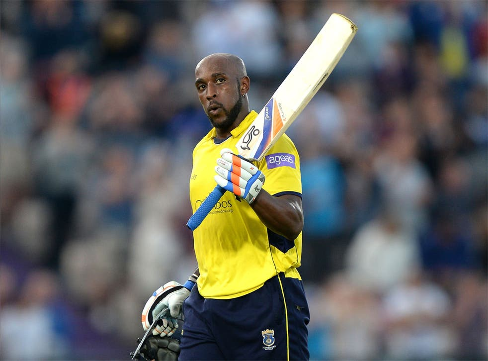 Michael Carberry raises his bat to the crowd as he leaves the  field of play