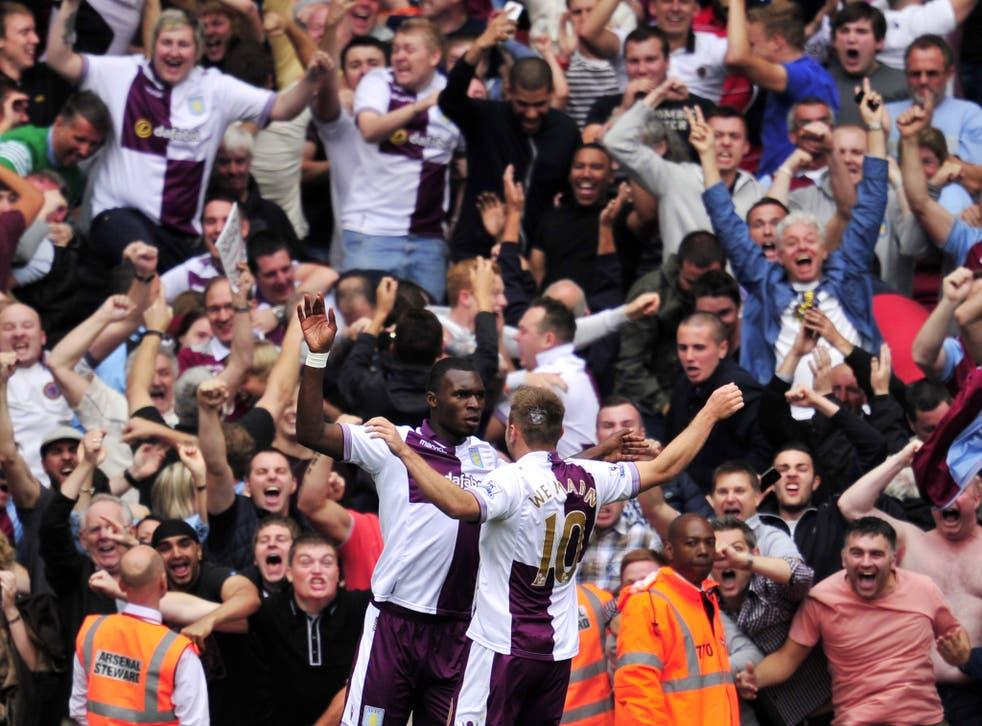 Christian Benteke celebrates scoring a penalty against Arsenal