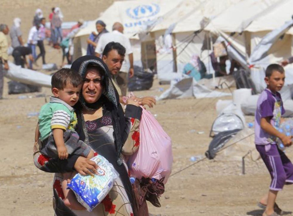 Thousands of Syrian refugees poured into the Kurdistan region of northern Iraq on Thursday, taking advantage of a new bridge along the largely closed border, the United Nations said on Friday