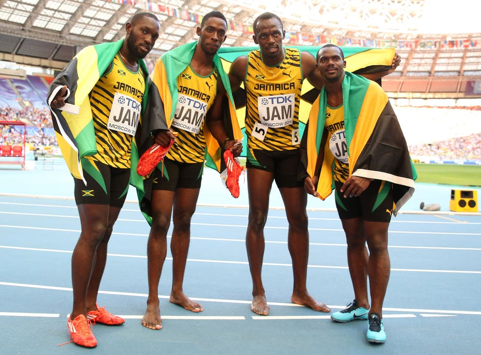 Usain Bolt (second from right), celebrates with Jamaican 4x100m team-mates (left to right) Nickel Ashmeade, Kemar Bailey-Cole, and Nesta Carter
