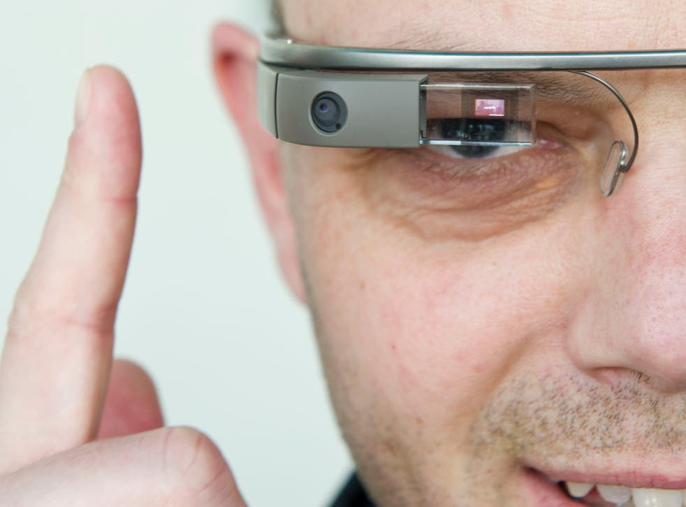 A visitor of the 'NEXT Berlin' conference tries out the Google Glass on April 24, 2013 in Berlin.