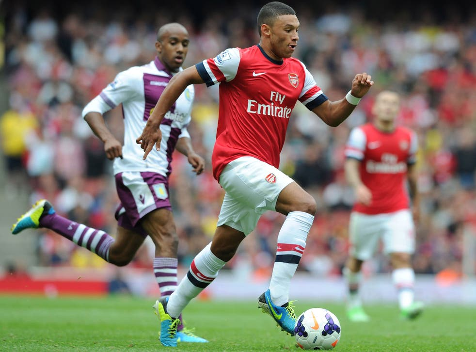 Alex Oxlade-Chamberlain in action against Aston Villa before being taken off with a knee injury