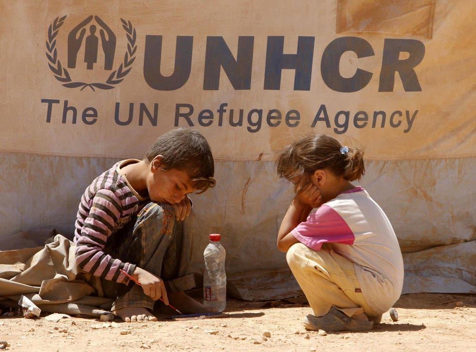 Syrian children playing in front of their tent at Zaatari Syrian refugee camp in Mafraq, Jordan