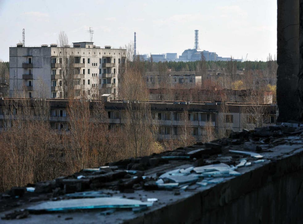 Decay of nature: the exploded reactor at the Chernobyl plant, seen from the ghost city of Pripyat