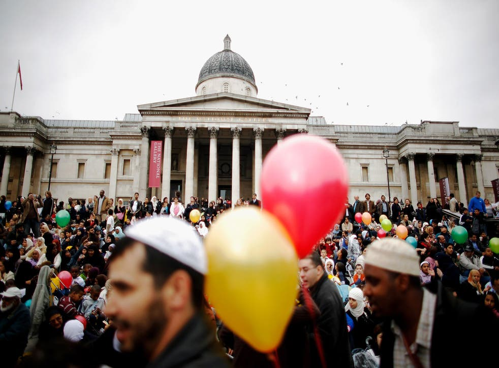 Muslims gather on the steps of Trafalgar Square to celebrate the end of Ramadan