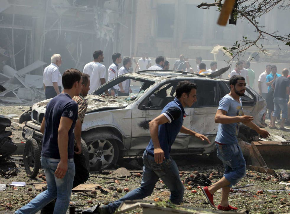 Lebanese citizens gather at the site of a powerful explosion in the northern Lebanese city of Tripoli