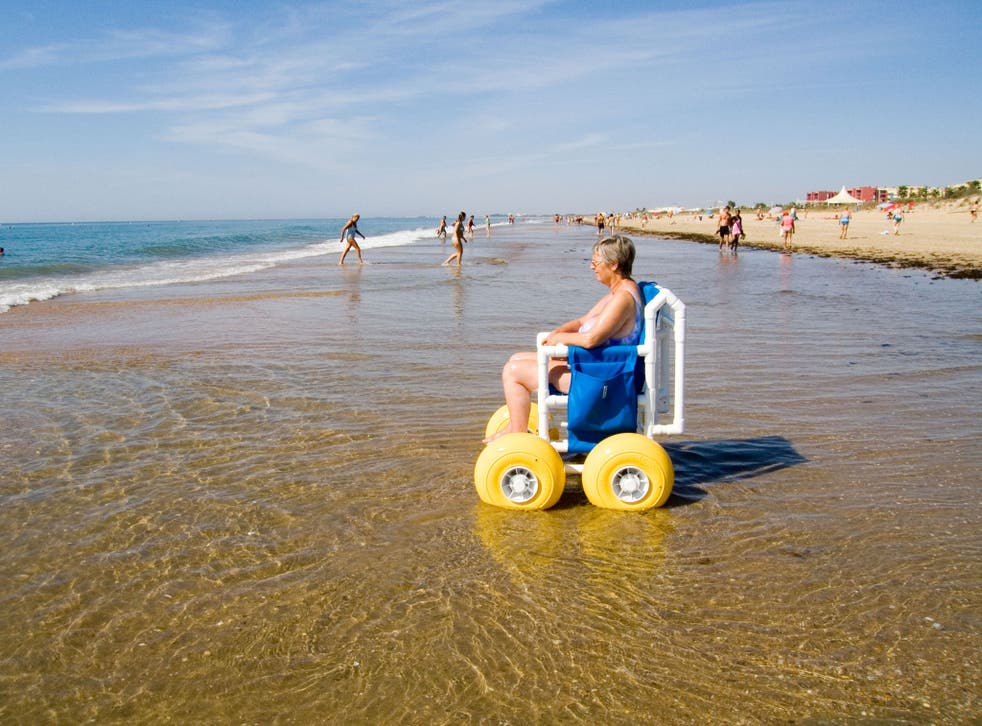 Sea life: with a beach wheelchair, a disabled visitor can go on the sand and take to the water