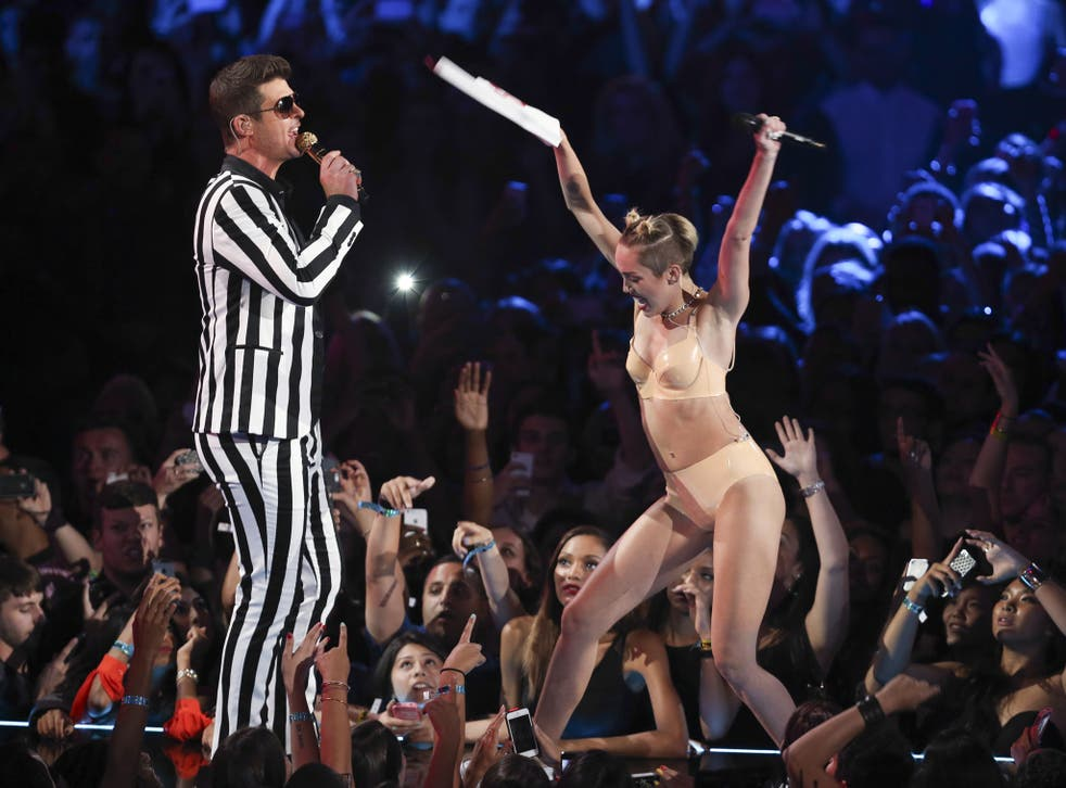 Shaking off her squeaky clean Hannah Montana image: Robin Thicke performs with Miley Cyrus at the VMAs.