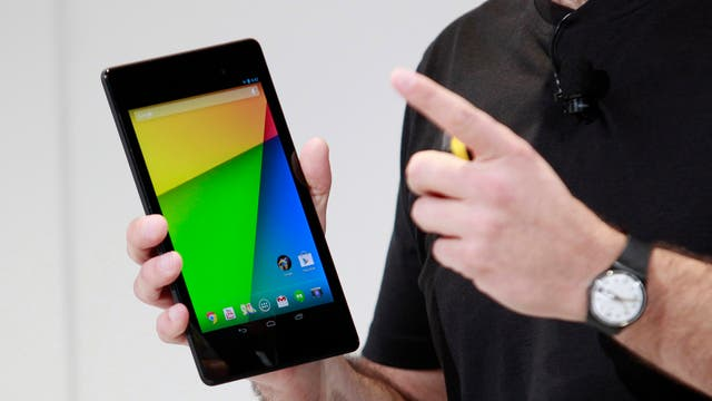 Hugo Barra, director of Product Management at Android, holds the new Nexus 7 tablet during a Google event at Dogpatch Studio in San Francisco, California.
