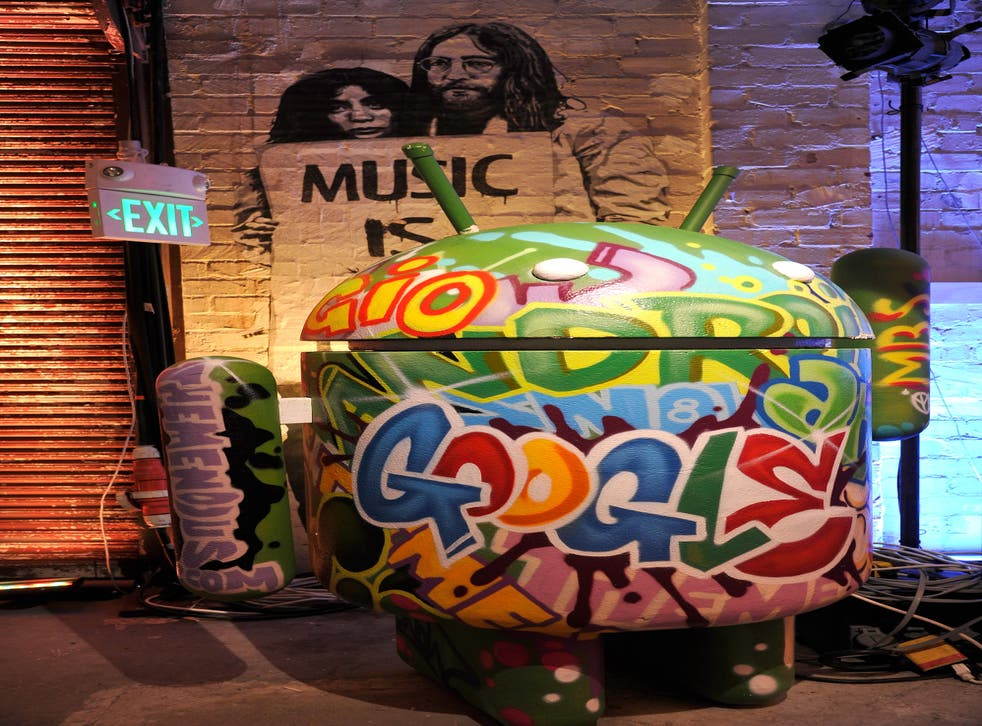 Google's Android mascot is shown decorated for the launch of Google Music in 2011.