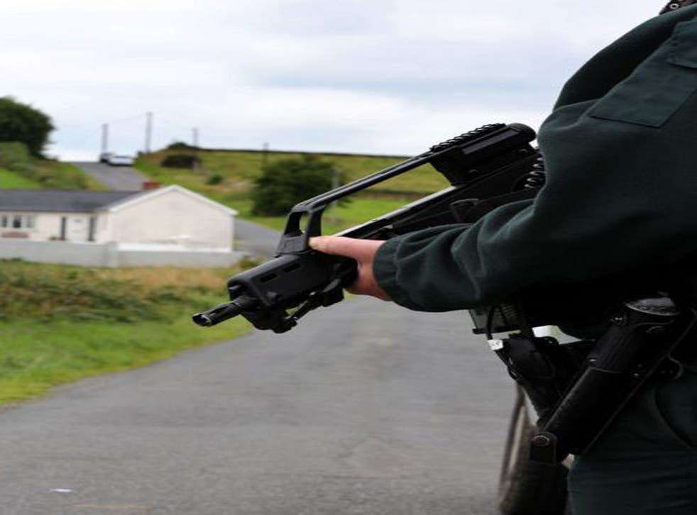 Police at the scene near the village of Cullyhanna, Northern Ireland, where a dissident republican-style rocket launcher has been discovered
