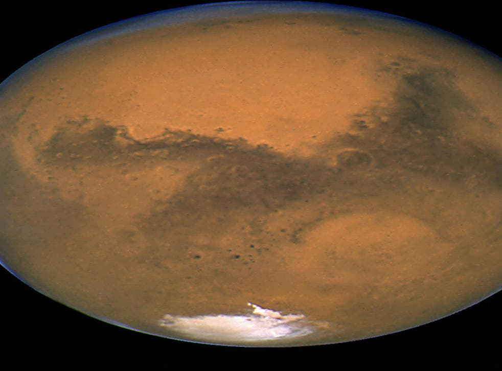 Growing evidence is suggesting that life on Earth may have actually begun on Mars, pictured.
