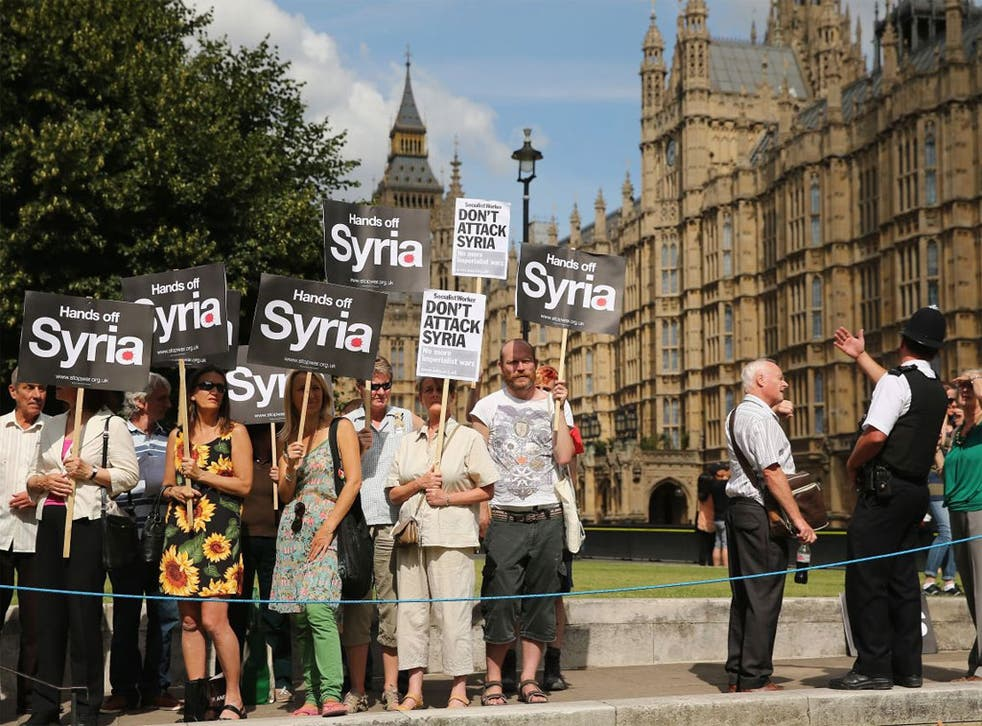 Protesters gather outside the Houses of Parliament yesterday