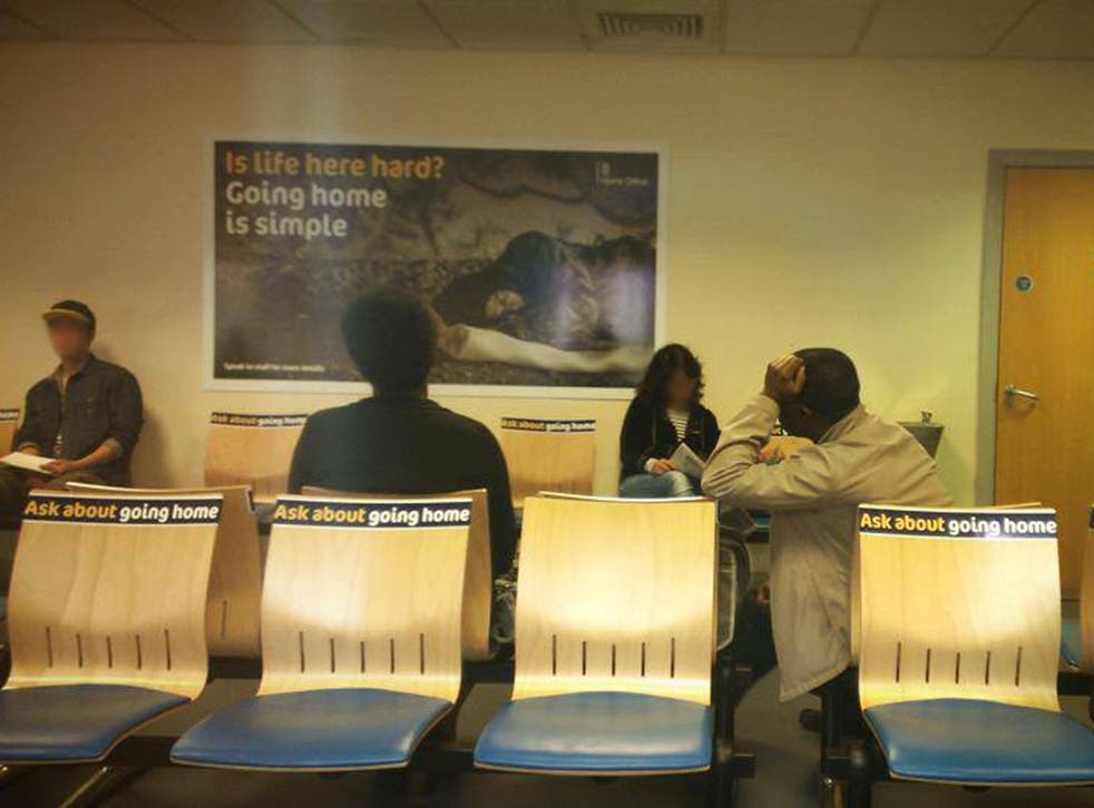 Scottish politicians have called the posters, seen here at a Glasgow reporting centre for migrants as 'shameful'