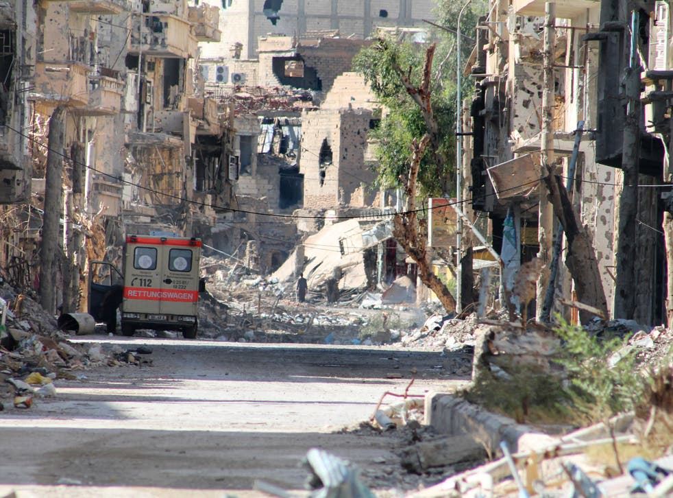 A general view shows a heavily damaged street in Syria's eastern town of Deir Ezzor on August 26