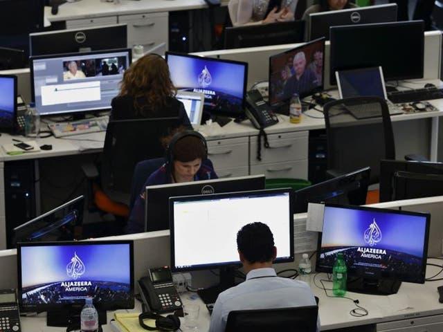 Journalists work in an Al-Jazeera news room as an Egyptian court orders Al-Jazeera Egypt to stop broadcasting.