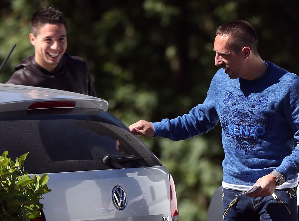 French forward Franck Ribery (R) speaks with midfielder Samir Nasri at the French national football team training base in Clairefontaine