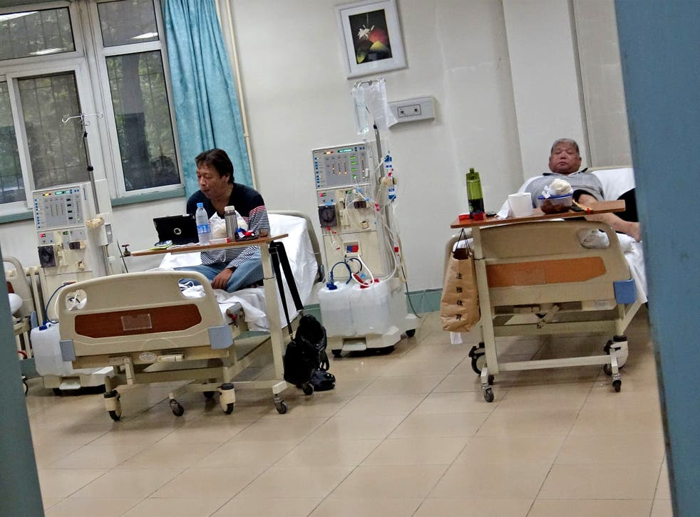 Two Chinese man receive treatment at a diabetes hospital in Beijing