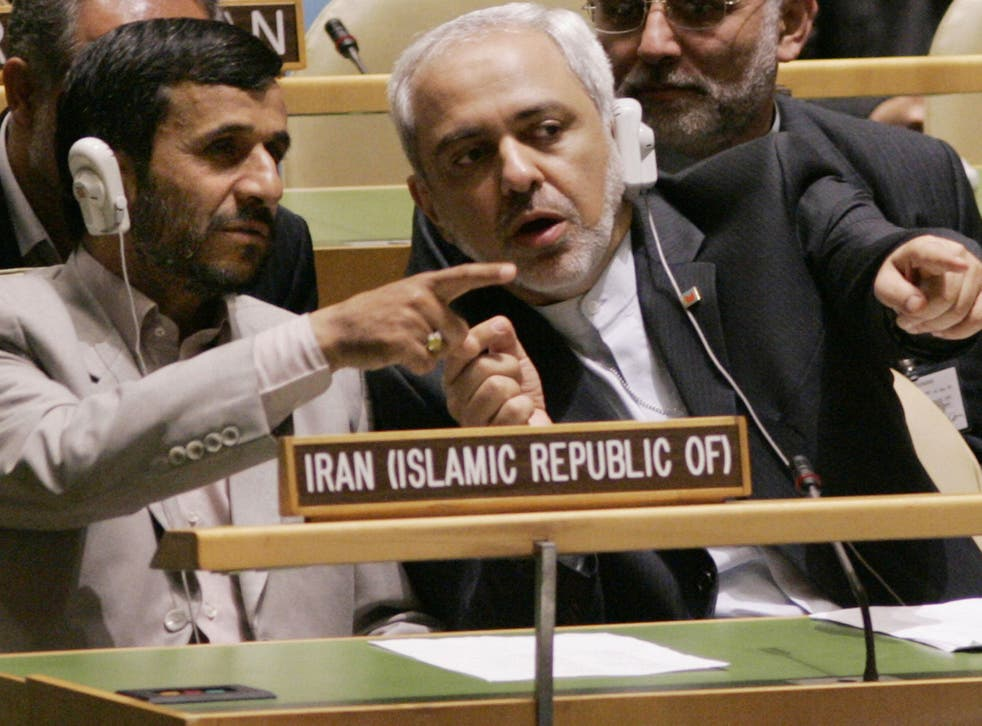 Mohammad Javad Zarif (right) with Mahmoud Ahmadinejad in 2006