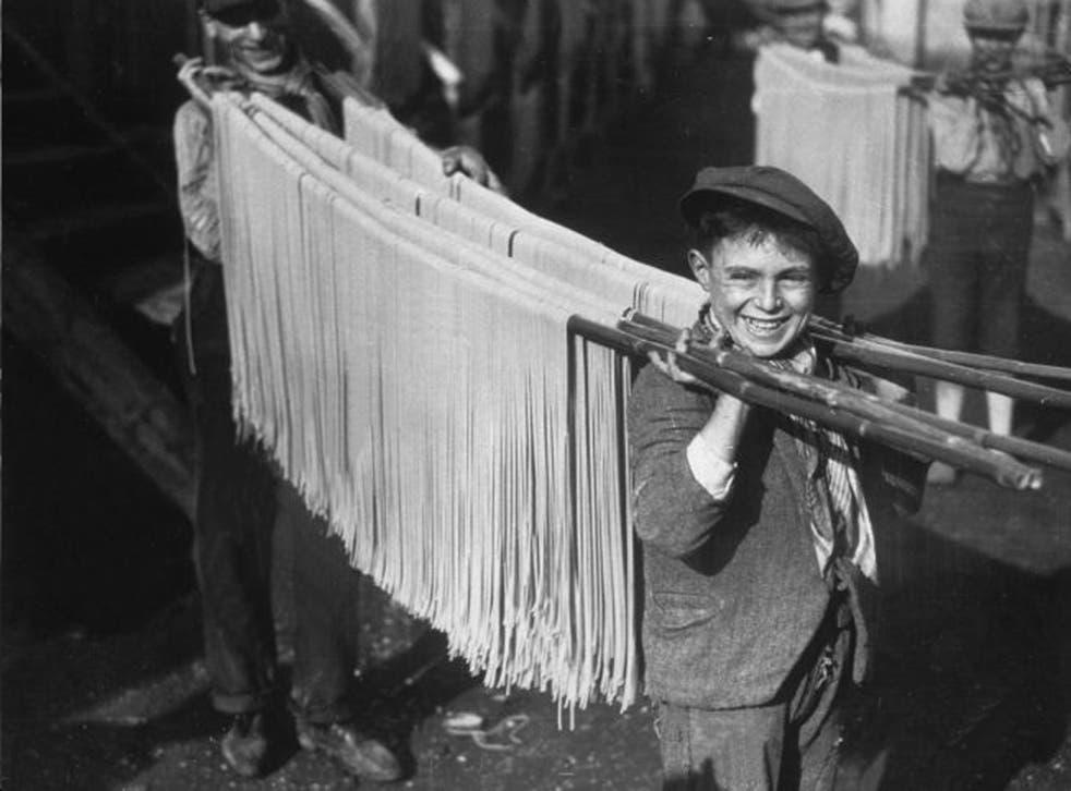 Buona! Boys carry spaghetti in 1929 Naples. Inset, Gennaro Contaldo